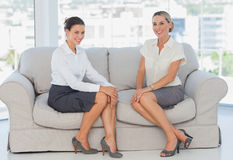 Business women sitting on the couch Stock Photo