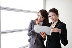 Business women smile conversation Stock Photos