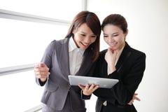 Business women smile conversation Stock Photo
