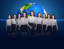 Business women stand with big earth. Business women stand on the blue background and big earth behind them. Elements of this image furnished by NASA Stock Image