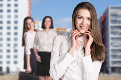 Business women stand on the street. In the city Stock Photography