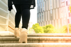 A business women is stepping on stair for successful stock images