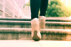 A business women is stepping on stair for successful royalty free stock photo