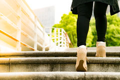 A business women is stepping on stair for successful stock photography