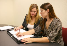 Business Women Taking Notes Royalty Free Stock Images