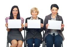 Business women team showing blank pages royalty free stock image