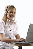 Business women telephone support. Business lady performing technical computer support with headset and white background Stock Photography