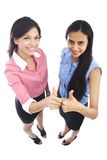 Business women with their thumbs up. Stock Images