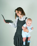 The business woman to the child and the netbook on hands Royalty Free Stock Photos