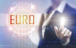 Business women touching the Euro screen Stock Photography