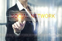 Business women touching the socail network screen royalty free stock photo