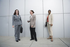 Business women waiting outside an office. Royalty Free Stock Photo