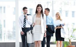 Modern business woman walking in the spacious lobby Royalty Free Stock Photos