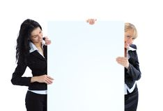 Business women with a white banner Royalty Free Stock Photography