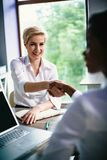 Business Women Work Together In One Large Company Royalty Free Stock Images