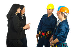 Business women and workers conversation Royalty Free Stock Photos