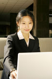 Business women working with laptop. Young business women working with laptop Royalty Free Stock Photos