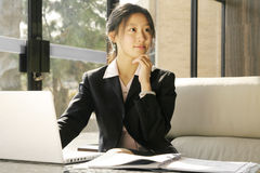 Business women working with laptop. Young business women working with laptop Royalty Free Stock Photography