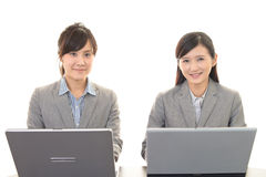 Business women working on a laptop Stock Image
