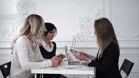 Business women working at meeting ,one of busines woman showing on a diagram. Business women working at meeting ,one of busines women showing on a diagram royalty free stock photos