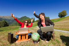 Business women working in nature Stock Photography