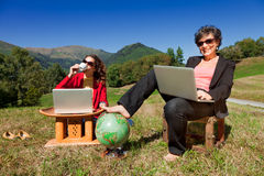 Business women working in nature Stock Images
