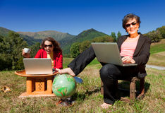 Business women working in nature Royalty Free Stock Image