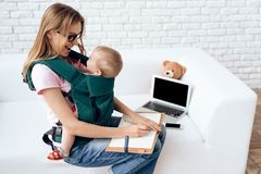 Business woman working with newborn in baby sling royalty free stock images