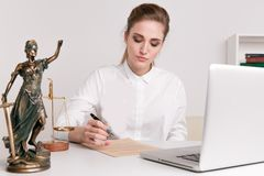 Lawyer business women working and notary signs the documents at office. consultant lawyer, justice and law ,attorney. Business woman working and notary signs the royalty free stock image