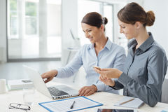 Business women working together on a laptop Royalty Free Stock Photo