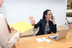 Business women in the workplace atmosphere Stock Images