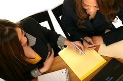 Business Women Writing On Notepad Stock Photo