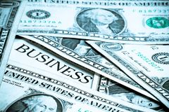 Business word with around a lot dollars Royalty Free Stock Photos