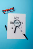 Business word with business document paper on blue background Royalty Free Stock Photos