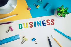 Business word on desk office background with supplies. Colorful of business working table.marketing concepts Stock Image