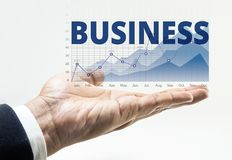 Business word with financial growing graph chart royalty free stock image