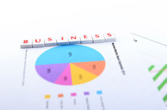 BUSINESS WORD PIECES ON A PAPER Stock Images