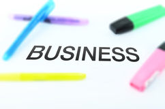 BUSINESS WORD SURROUNDED BY HIGHLIGHTER PENS Royalty Free Stock Photography