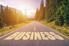 Business word written on road in the mountains.  royalty free stock image