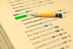 BUSINESS - The words highlight in the book and pencil Stock Image