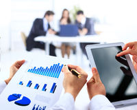 Business work-group analyzing financial data Royalty Free Stock Photo