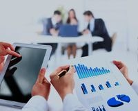 Business work-group analyzing financial data in office. Royalty Free Stock Image
