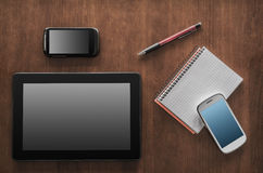 Business Work With Tablet, 2 Smartphones And A Notepad Royalty Free Stock Photography