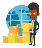 Business worker of international delivery service. African businessman holding cardboard box. Happy businessman working in international delivery service Stock Photography
