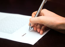 Business worker signing the contract. On table Royalty Free Stock Image