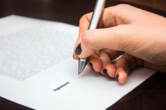 Business worker signing the contract. On table Stock Images