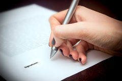 Business worker signing the contract. On table Royalty Free Stock Images