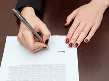 Business worker signing the contract. On a table Royalty Free Stock Images