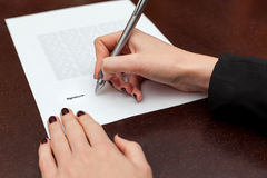 Business worker signing the contract. On a table Royalty Free Stock Image