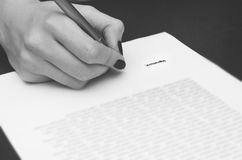 Business worker signing the contract. On table. Black white Stock Images